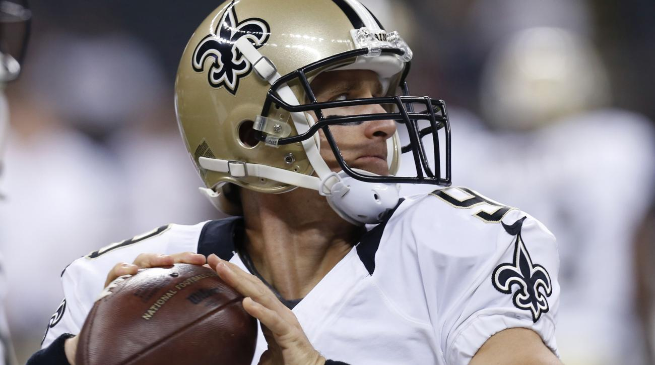 FILE - In this Aug. 30, 2015, file photo, New Orleans Saints quarterback Drew Brees (9) warms up before an NFL preseason football game against the Houston Texans in New Orleans. One constant for New Orleans is 36-year-old quarterback Drew Brees, who tied