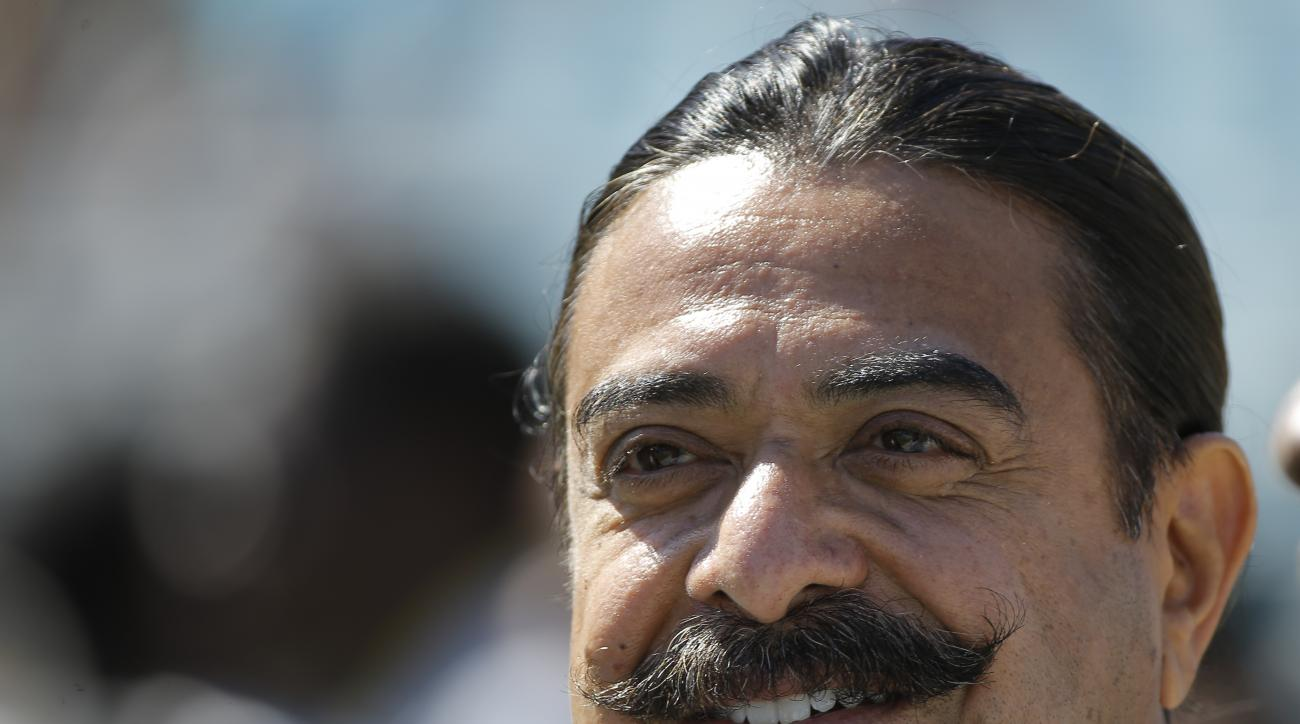FILE - In this Oct. 19, 2014, file photo, Jacksonville Jaguars team owner Shad Khan watches players warm up before an NFL football game against the Cleveland Browns in Jacksonville, Fla. Shad Khan expects to sign a long-term deal to continue playing annua