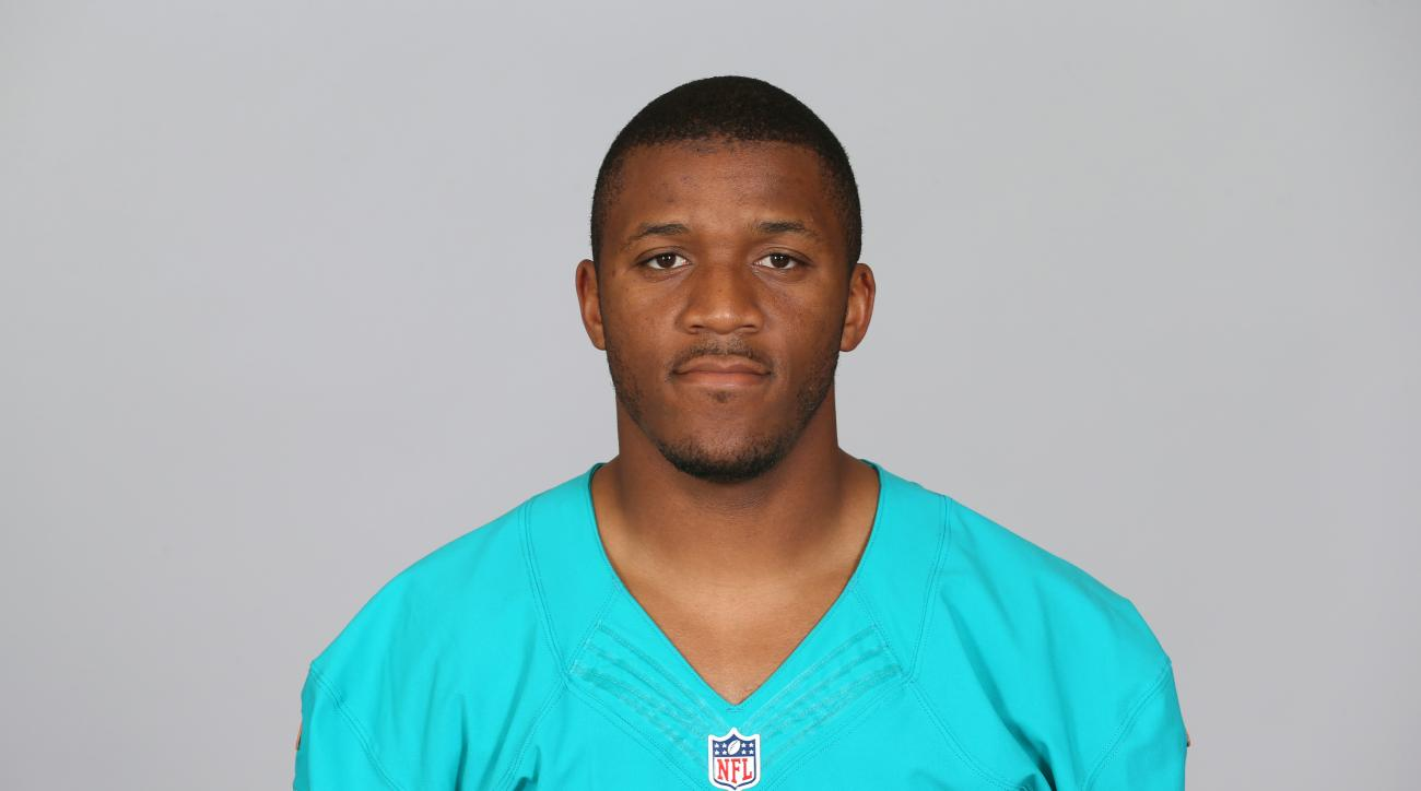 FILE - This is a 2015 file photo showing LaMichael James of the Miami Dolphins NFL football team. If LaMichael James is to make the Miami Dolphins' final roster, he'll do it as LaMike. James says he prefers the shorter first name, and he'll be identified