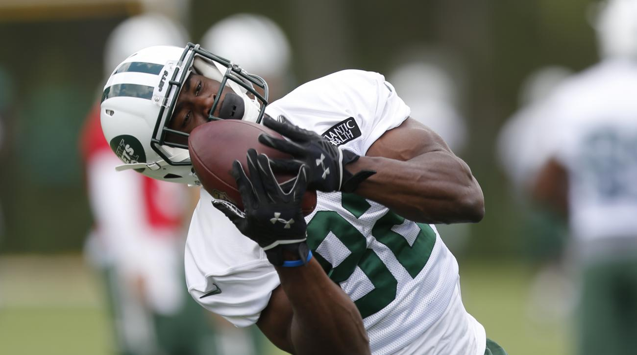 FILE - In this June 3, 2015, file photo, New York Jets wide receiver Quincy Enunwa makes a catch during organized team activities at the team's NFL football training center in Florham Park, N.J. Enunwa has been all over the field for the New York Jets thi