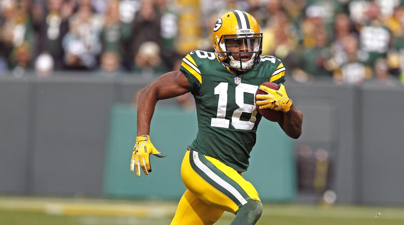 FILE - In this Oct. 19, 2014 file photo, Green Bay Packers wide receiver Randall Cobb runs after making a catch against the Carolina Panthers during an NFL football game in Green Bay, Wis. The Green Bay Packers sure haven't been generous in sharing their