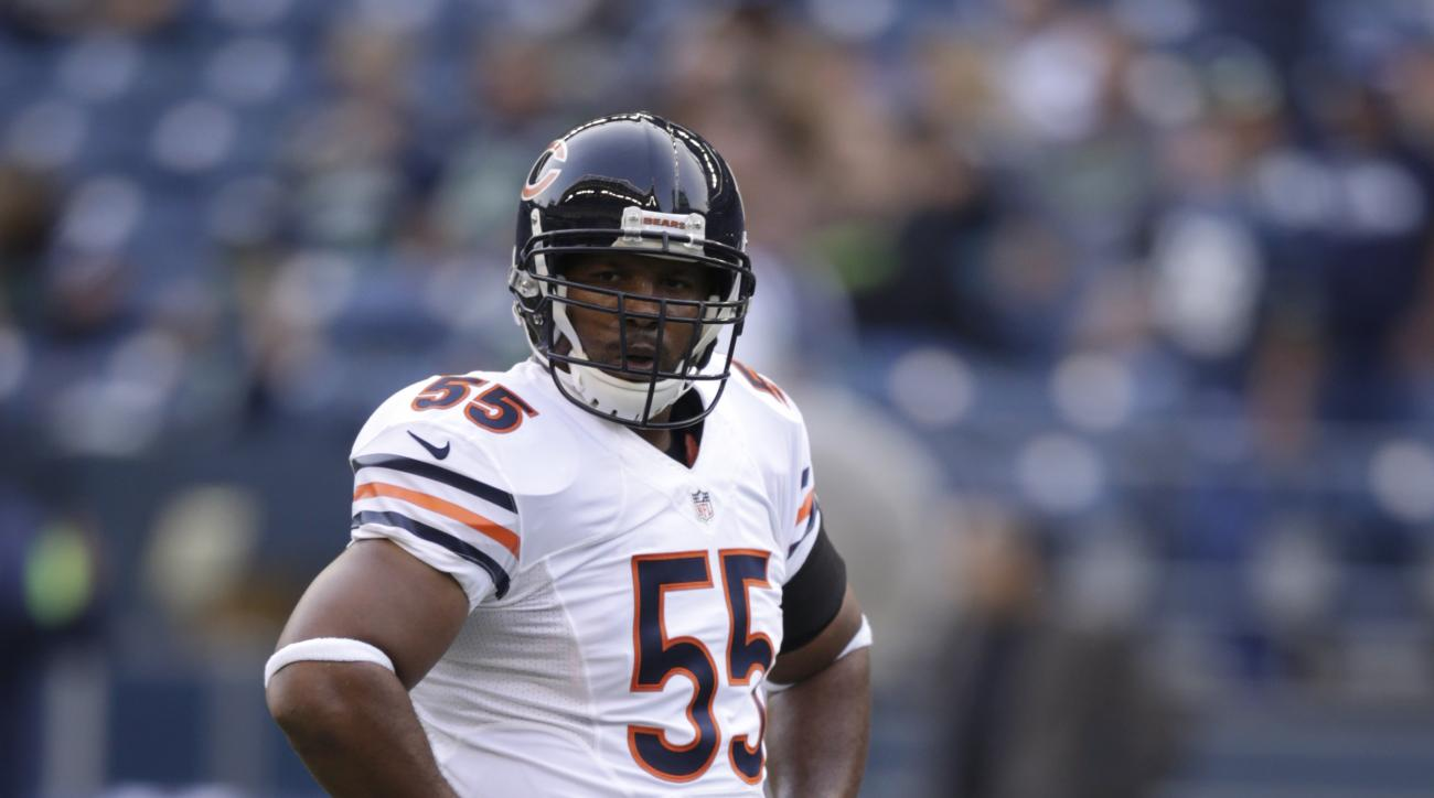 Chicago Bears' Lance Briggs warms-up before a preseason NFL football game against the Seattle Seahawks, Friday, Aug. 22, 2014, in Seattle. (AP Photo/Stephen Brashear)