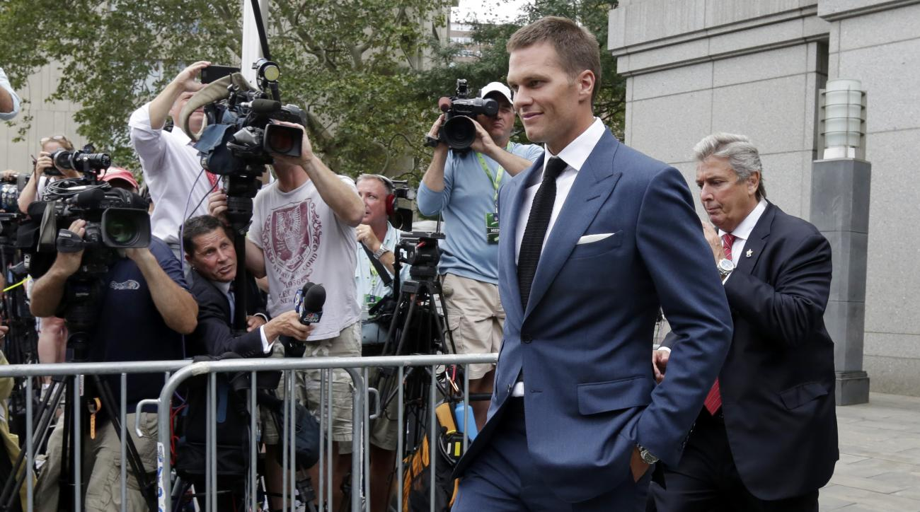 "FILE - In this April 31, 2015, file photo, New England Patriots quarterback Tom Brady leaves Federal court in New York.  Brady can suit up for his team's season opener after a judge erased his four-game suspension for ""Deflategate."" (AP Photo/Richard Drew"