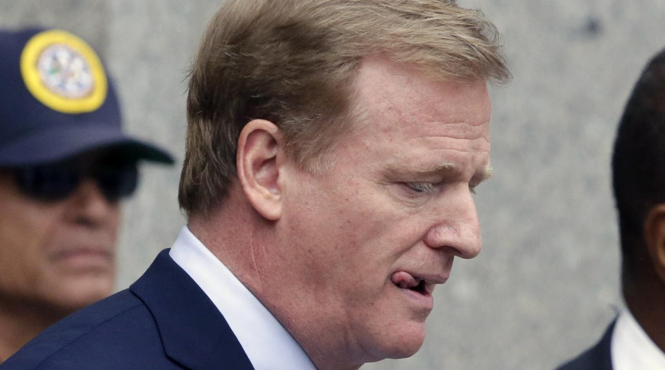 """FILE - In this Aug. 31, 2015, file photo, NFL Commissioner Roger Goodell leaves federal court Monday in New York. New England Patriots quarterback Tom Brady can suit up for his team's season opener after a judge erased his four-game suspension for """"Deflat"""