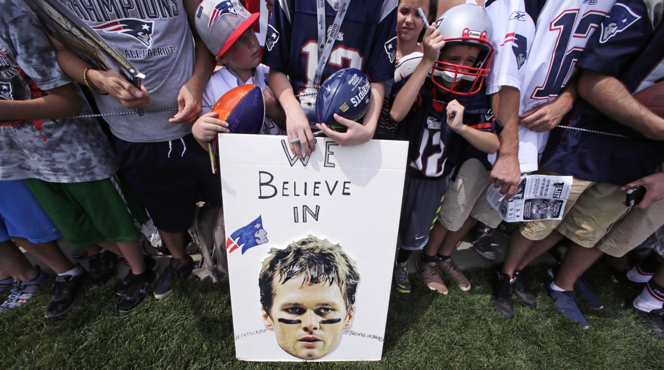 "FILE - In this July 30, 2015, file photo, New England Patriots fans wait for practice to complete, while standing behind a sign supporting quarterback Tom Brady, during an NFL football training camp in Foxborough, Mass. A federal judge deflated ""Deflatega"