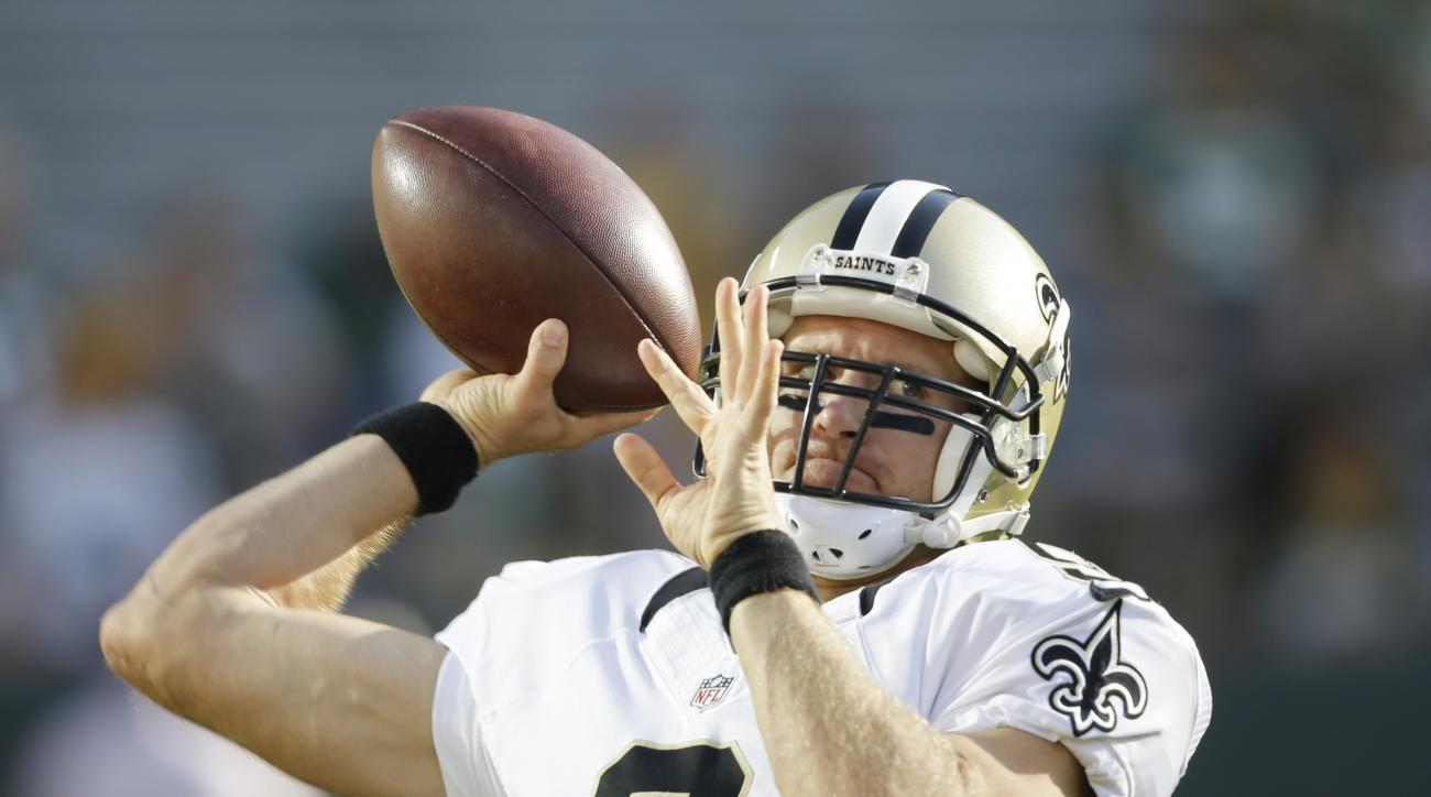 New Orleans Saints quarterback Drew Brees throws before a preseason NFL football game against the Green Bay Packers Thursday, Sept. 3, 2015, in Green Bay, Wis. (AP Photo/Jeffrey Phelps)