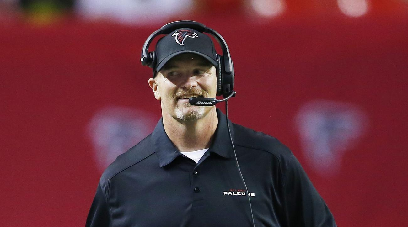 Atlanta Falcons head coach Dan Quinn walk down the sidelines during the first half of an NFL football preseason game against the Baltimore Ravens, Thursday, Sept. 3, 2015, in Atlanta. (AP Photo/John Bazemore)