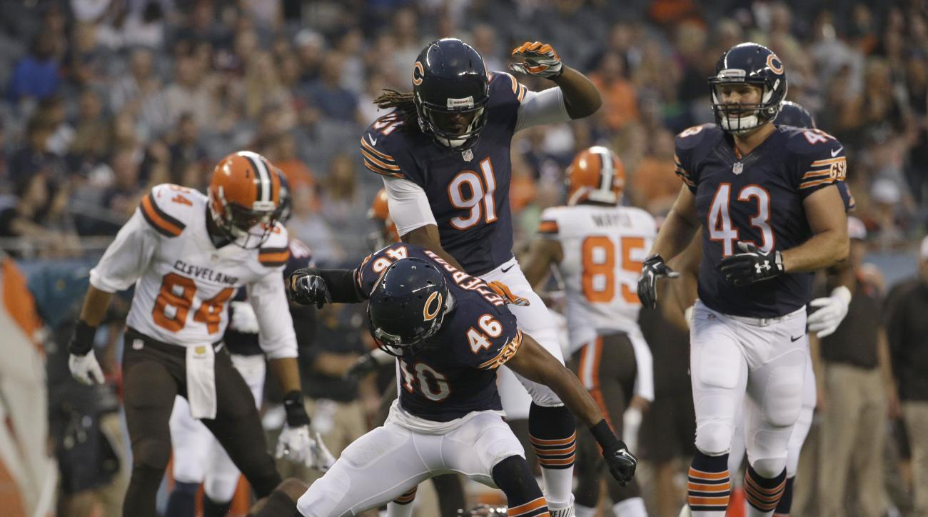 Chicago Bears strong safety Anthony Jefferson (46) celebrates with linebacker David Bass (91) after tackling Cleveland Browns' De'Ante Saunders (40) on a punt return during the first half of an NFL preseason football game, Thursday, Sept. 3, 2015, in Chic