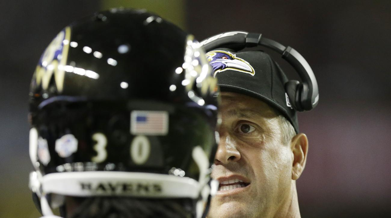 Baltimore Ravens head coach John Harbaugh speaks with Baltimore Ravens running back Terrence Magee (30) on the sidelines during the first half of an NFL football preseason game against the Atlanta Falcons, Thursday, Sept. 3, 2015, in Atlanta. (AP Photo/Br