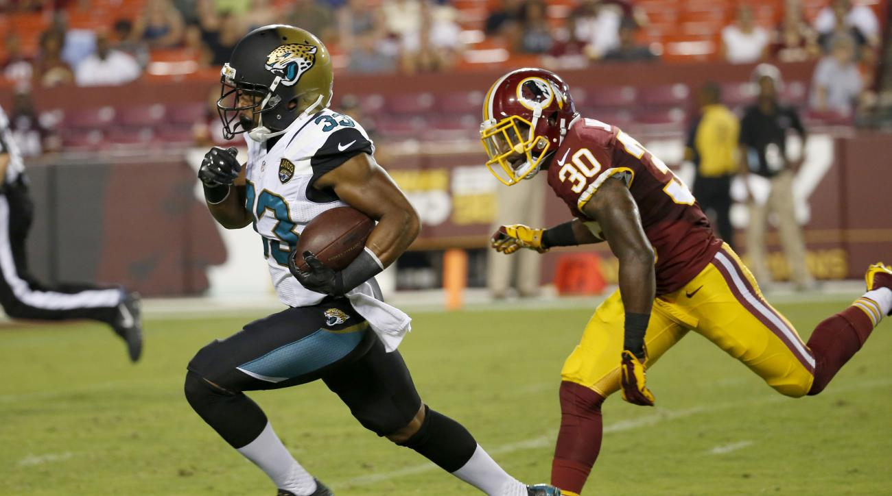 Jacksonville Jaguars running back Corey Grant (33) out runs Washington Redskins strong safety Kyshoen Jarrett (30) for a touchdown during the first half of an NFL preseason football game in Landover, Md., Thursday, Sept. 3, 2015. (AP Photo/Alex Brandon)