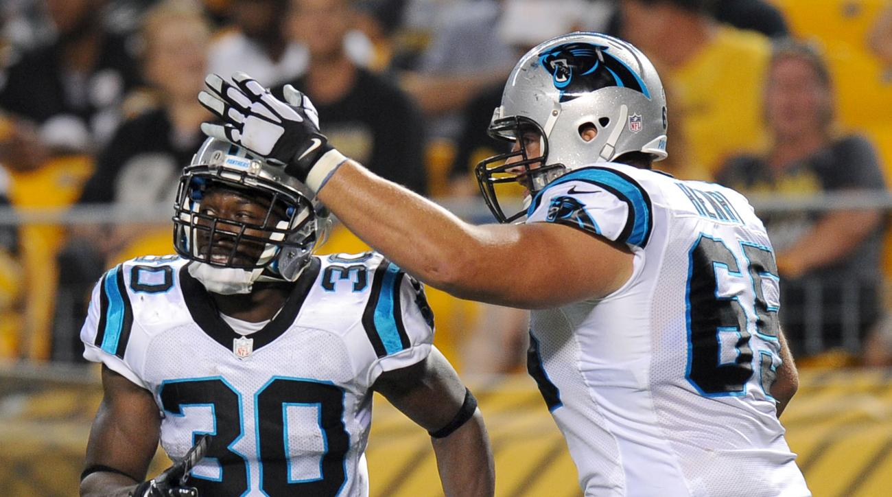 Carolina Panthers running back Jordan Todman (30) is greeted by guard Rick Henry (65) after making a long touchdown run against the Pittsburgh Steelers during the second quarter of an NFL preseason football game, Thursday, Sept. 3, 2015, in Pittsburgh. (A