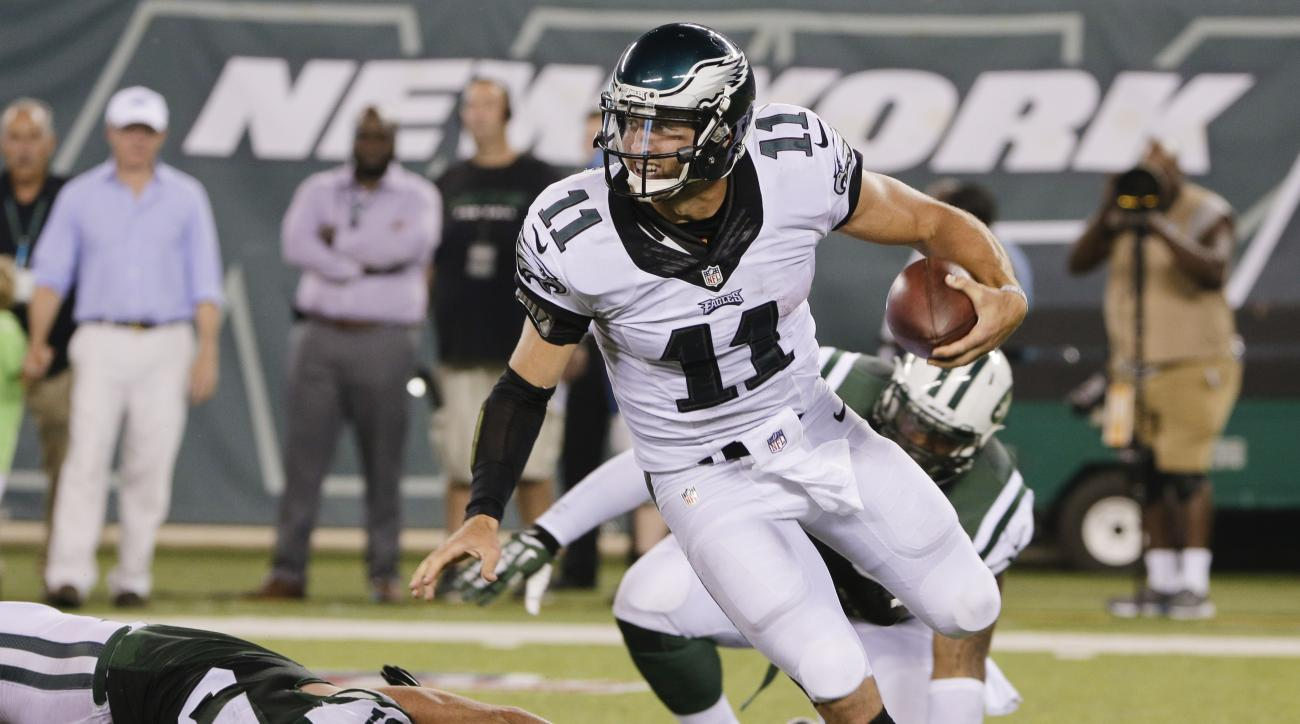Philadelphia Eagles quarterback Tim Tebow (11) avoids a sack by New York Jets' Trevor Reilly (57) during the first half of a preseason NFL football game Thursday, Sept. 3, 2015  in East Rutherford, N.J. (AP Photo/Peter Morgan)