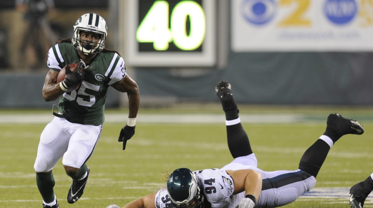 New York Jets running back Daryl Richardson (35) runs away from Philadelphia Eagles' Beau Allen (94) during the second half of a preseason NFL football game Thursday, Sept. 3, 2015  in East Rutherford, N.J. (AP Photo/Bill Kostroun)