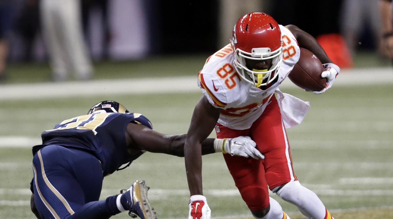 Kansas City Chiefs wide receiver Frankie Hammond, right, runs with the ball as St. Louis Rams strong safety Maurice Alexander defends during the second quarter of an NFL preseason football game Thursday, Sept. 3, 2015, in St. Louis. (AP Photo/Tom Gannam)