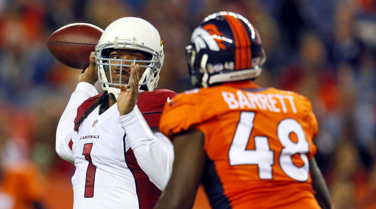 Arizona Cardinals quarterback Phillip Sims (1) throws over Denver Broncos linebacker Shaquil Barrett (48) during the first half of an NFL preseason football game, Thursday, Sept. 3, 2015, in Denver. (AP Photo/Joe Mahoney)