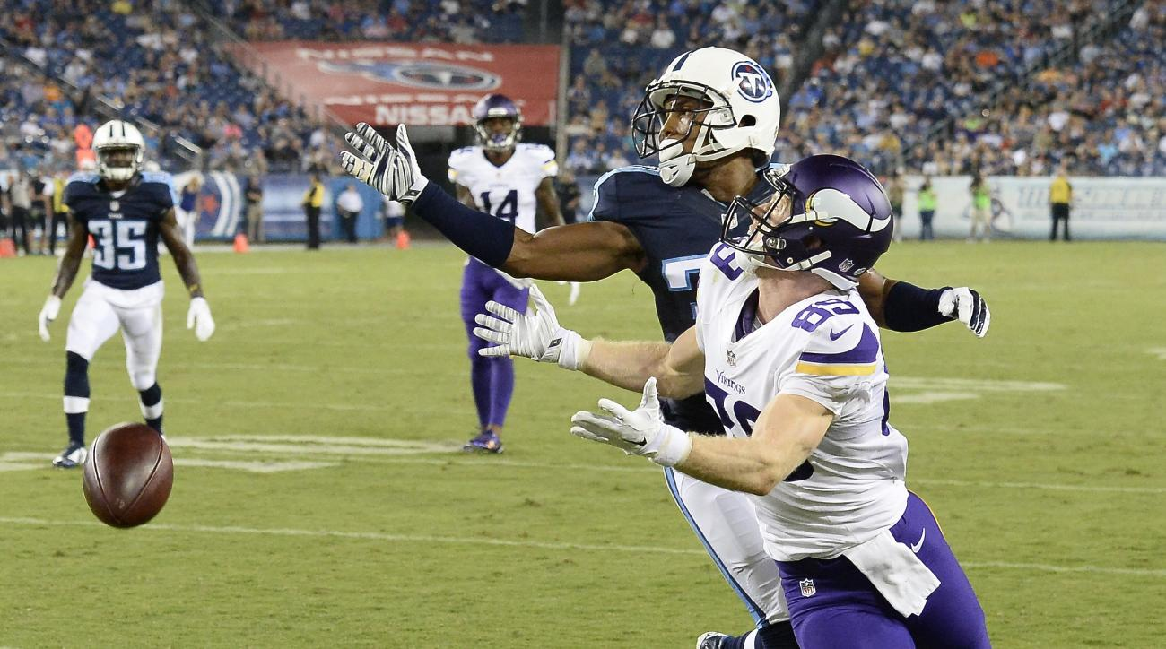 Minnesota Vikings wide receiver Ryan Whalen (89) can't hold onto a pass as he is defended by Tennessee Titans cornerback Cody Riggs in the second half of a preseason NFL football game Thursday, Sept. 3, 2015, in Nashville, Tenn. (AP Photo/Mark Zaleski)