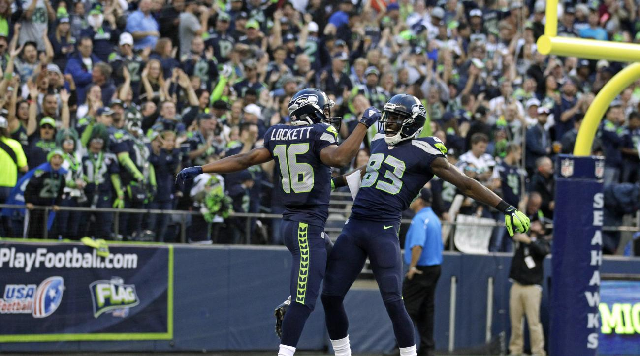 Seattle Seahawks wide receiver Tyler Lockett (16) celebrates with Seattle Seahawks wide receiver Ricardo Lockette (83) after Lockett ran for a touchdown after catching a pass from quarterback Russell Wilson in the first half of a preseason NFL football ga