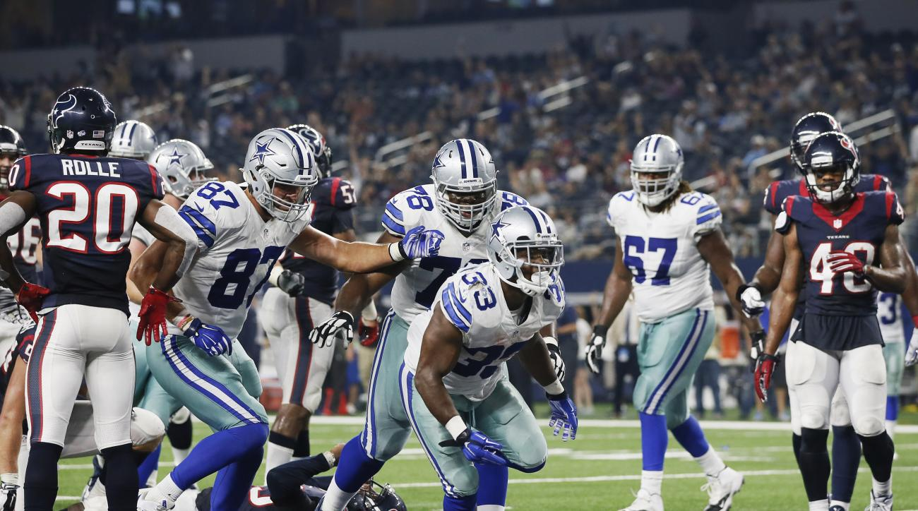 Dallas Cowboys running back Ben Malena (33) runs through the end zone after scoring a touchdown against the Houston Texans during the second half of a preseason NFL football game Thursday, Sept. 3, 2015, in Arlington, Texas. (AP Photo/Tony Gutierrez)