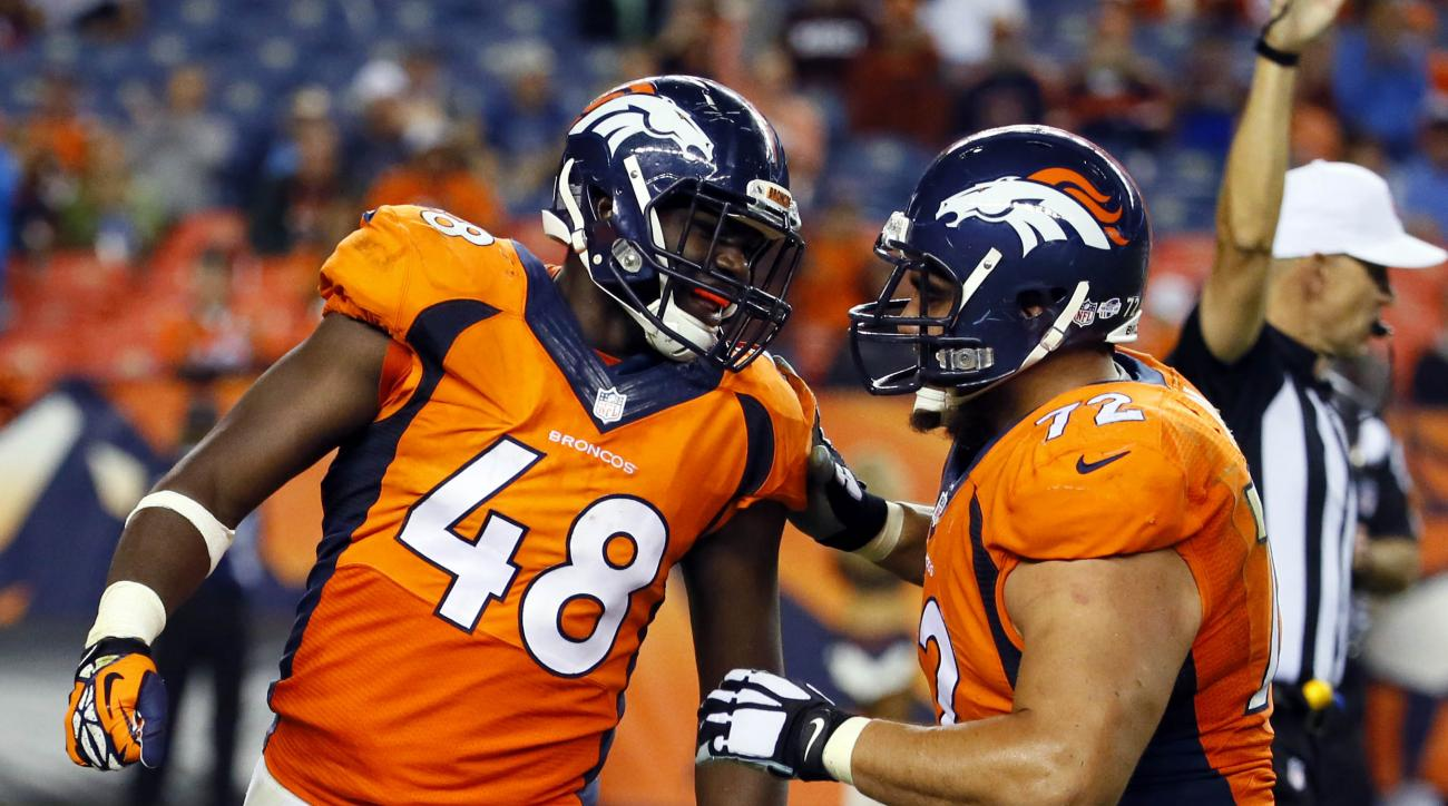 Denver Broncos linebacker Shaquil Barrett (48) celebrates a sack with teammate Sione Fua (72) against the Arizona Cardinals during the second half of an NFL preseason football game, Thursday, Sept. 3, 2015, in Denver. (AP Photo/Jack Dempsey)