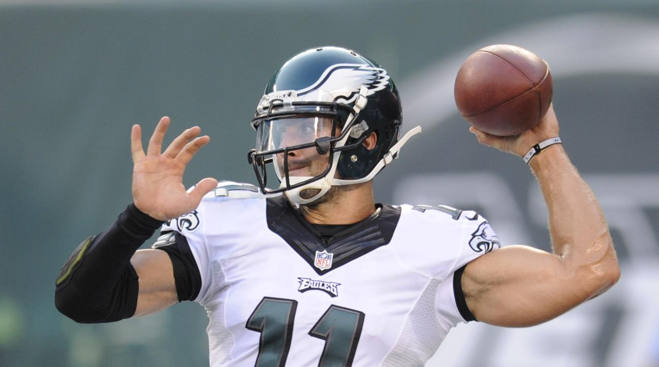 FILE - In this Sept. 3, 2015, file photo, Philadelphia Eagles quarterback Tim Tebow throws a pass before a preseason NFL football game against the New York Jets in East Rutherford, N.J. Two people familiar with the move say the Eagles released Tebow. Both