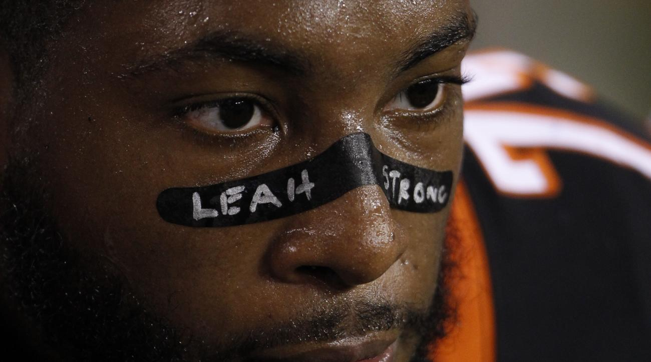 """Cincinnati Bengals defensive tackle Devon Still sits on the bench with """"Leah Strong"""" written on his face in the second half of a NFL preseason football game against the Chicago Bears, Saturday, Aug. 29, 2015, in Cincinnati. (AP Photo/Frank Victores)"""