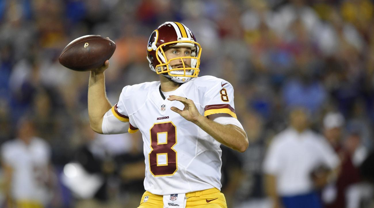 FILE - In this photo taken Aug. 29, 2015, file photo Washington Redskins quarterback Kirk Cousins throws to a receiver in the first half of a preseason NFL football game against the Baltimore Ravens, in Baltimore. Early on in training camp, new Washington
