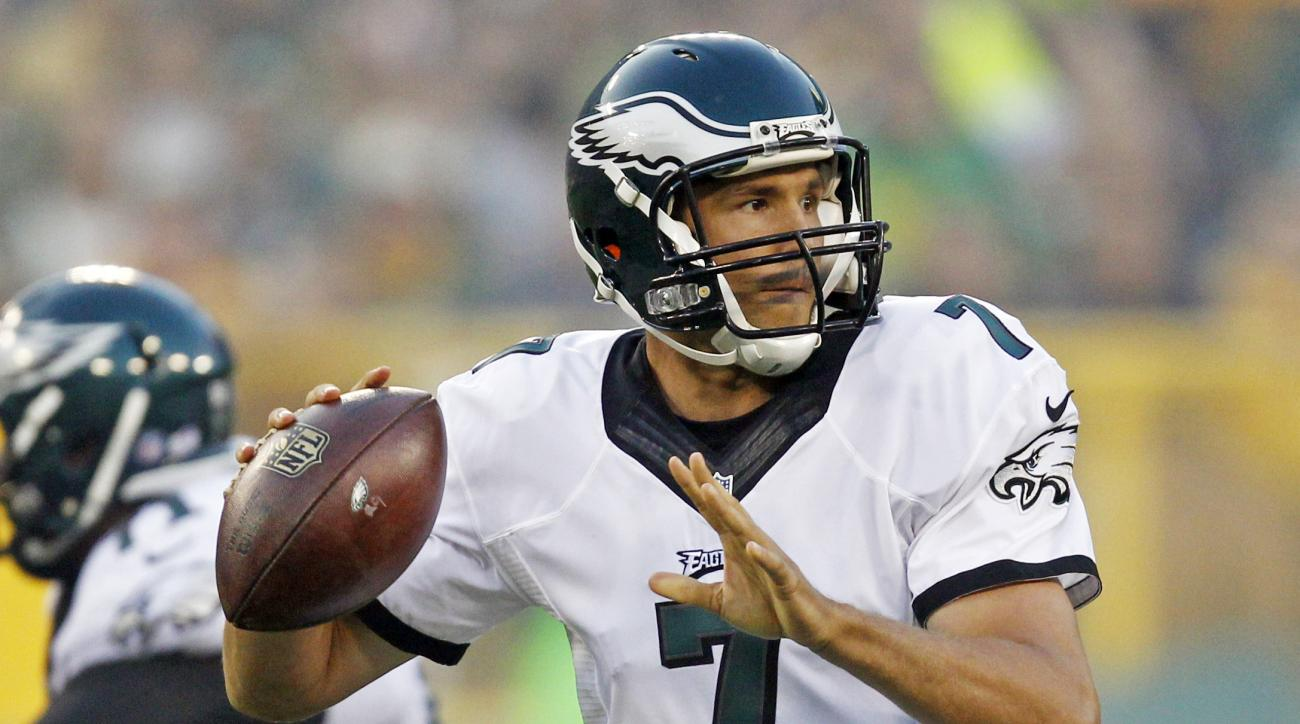 FILE - In this Aug. 29, 2015, file photo, Philadelphia Eagles quarterback Sam Bradford drops back to pass during the first half of an NFL football game against the Green Bay Packers in Green Bay, Wis. Eagles coach Chip Kelly couldn't land Marcus Mariota i