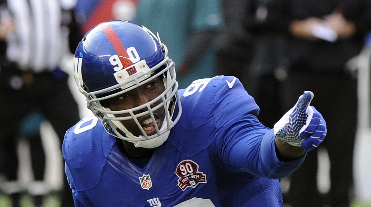 FILE - In this Sunday, Dec. 28, 2014, file photo, New York Giants' Jason Pierre-Paul (90) reacts after sacking Philadelphia Eagles' Mark Sanchez during the first half of an NFL football game in East Rutherford, N.J. The Giants have no firsthand knowledge