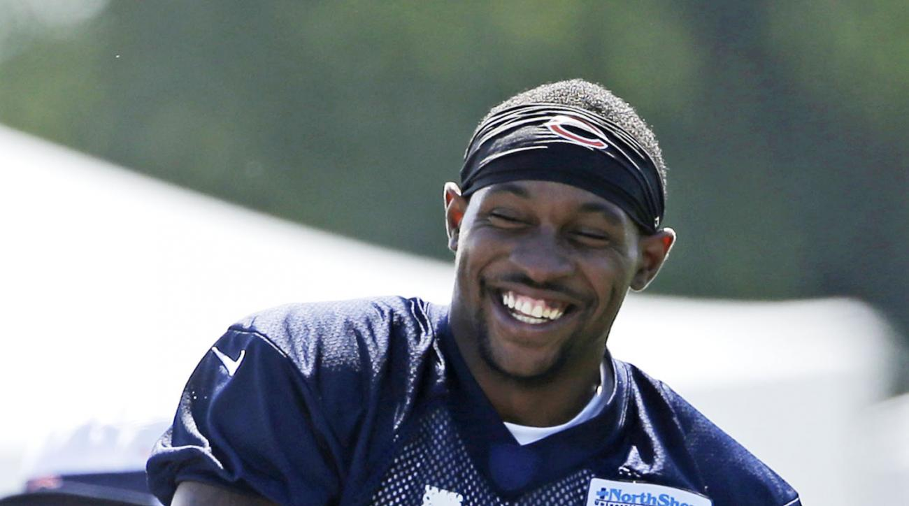 FILE - In this July 31, 2015, file photo, Chicago Bears wide receiver Alshon Jeffery smiles as he stretches during an NFL football training camp at Olivet Nazarene University in Bourbonnais, Ill. Jeffery practiced for the first time in nearly a month Wedn