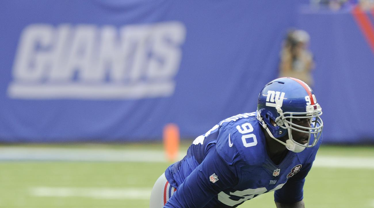 FILE - In this Sept. 21, 2014, file photo, New York Giants defensive end Jason Pierre-Paul (90) comes up off the line of scrimmage against the Houston Texans during an NFL football game in East Rutherford, N.J. Two-time Pro Bowl defensive end Jason Pierre