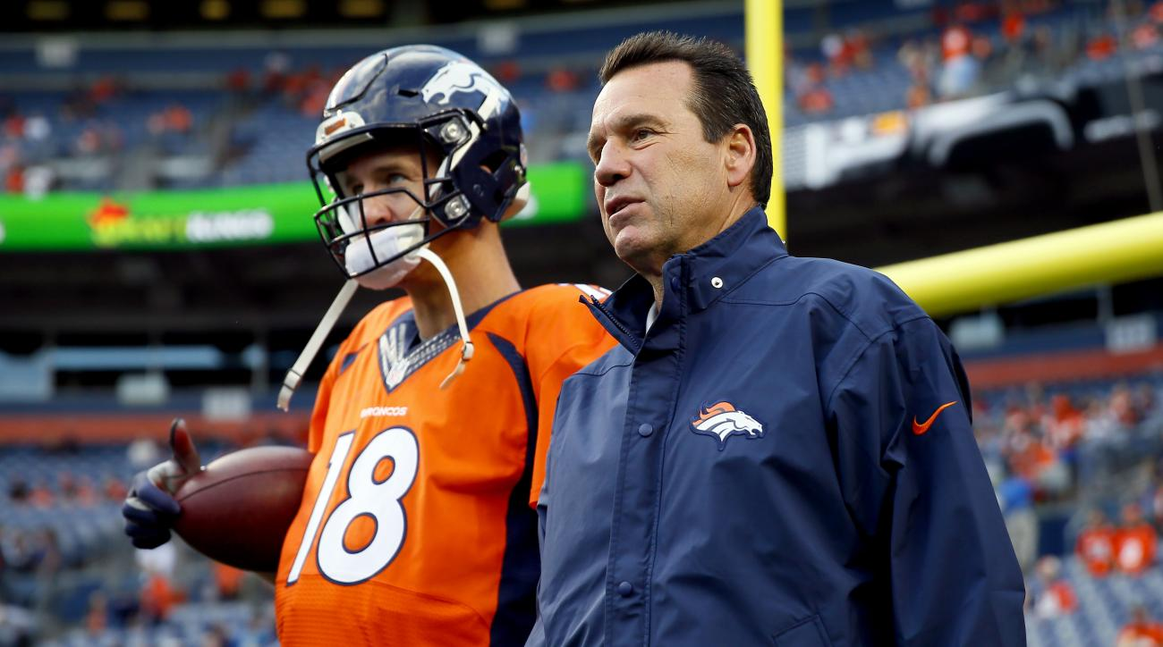 FILE - In this Sept. 3, 2015, file photo, Denver Broncos quarterback Peyton Manning (18) talks with head coach Gary Kubiak prior to an NFL preseason football game against the Arizona Cardinals in Denver. The Ravens enjoyed having Gary Kubiak on their side