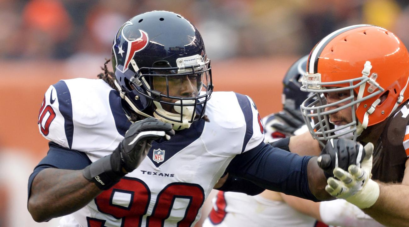 FILE - In this Nov. 16, 2014, file photo, Houston Texans outside linebacker Jadeveon Clowney (90) rushes against Cleveland Browns tackle Joe Thomas in the third quarter of an NFL football game in Cleveland. Clowney was reminded this week that he injured h
