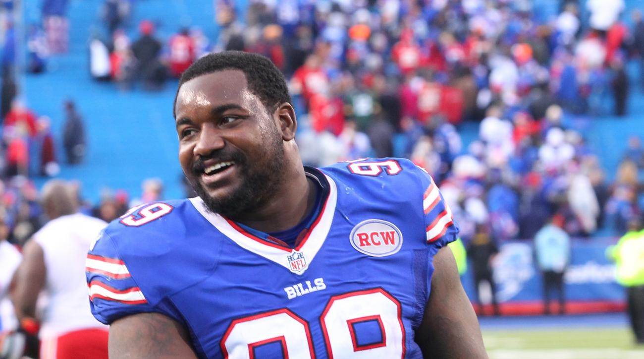 FILE - In this Nov. 9, 2014, file photo, Buffalo Bills defensive tackle Marcell Dareus (99) walks off the field after an NFL football game against the Kansas City Chiefs in Orchard Park, N.Y. The Buffalo Bills now have two $100 million starters fronting t