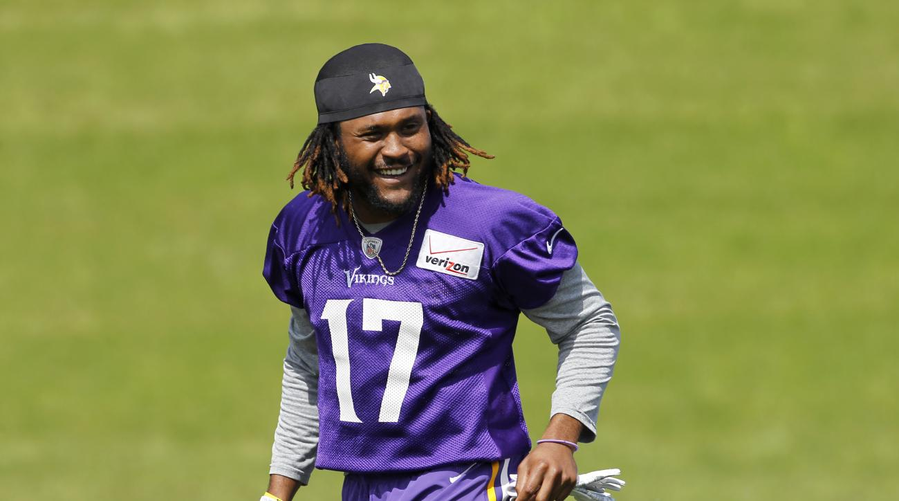Minnesota Vikings wide receiver Jarius Wright (17) smiles at a teammate during NFL football minicamp in Eden Prairie, Minn., Thursday, June 18, 2015. (AP Photo/Ann Heisenfelt)
