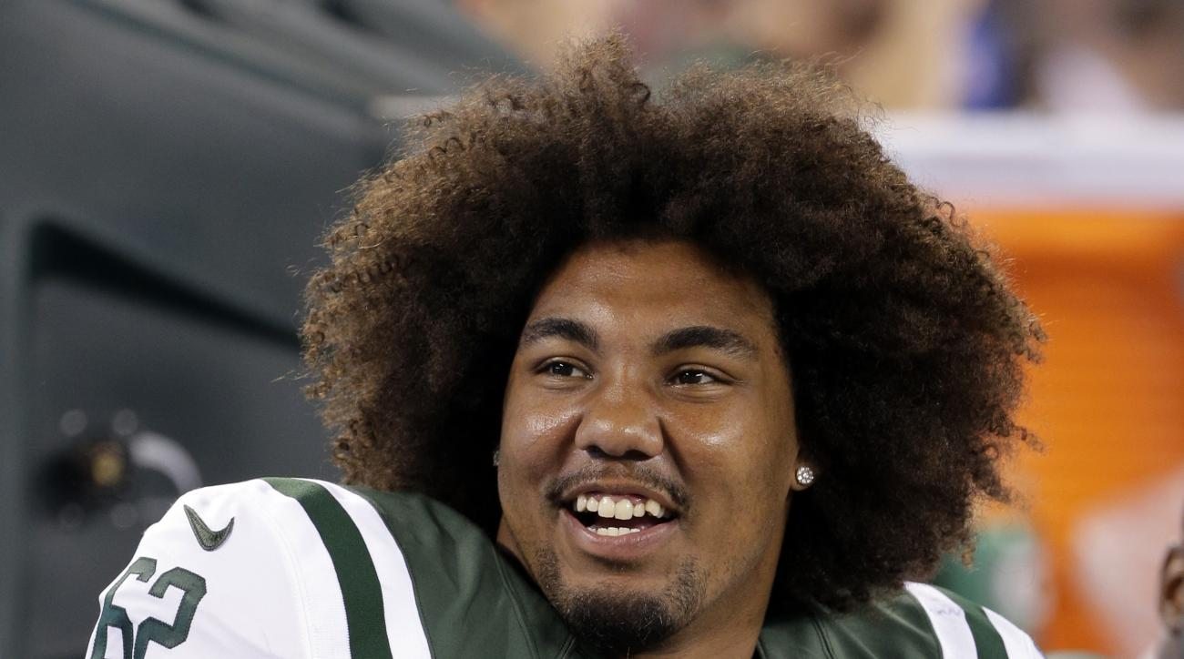 FILE - In this Sept. 3, 2015, file photo, New York Jets defensive tackle Leonard Williams talks with  teammates during the second half of a preseason NFL football game against the Philadelphia Eagles in East Rutherford, N.J. Williams is a large man with h