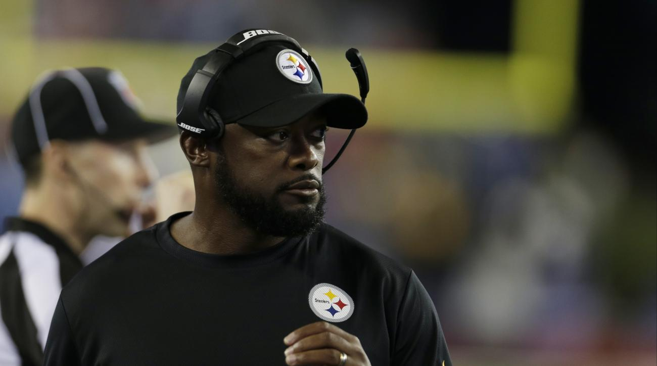 Pittsburgh Steelers head coach Mike Tomlin watches from the sideline in the first half of an NFL football game against the New England Patriots, Thursday, Sept. 10, 2015, in Foxborough, Mass. (AP Photo/Charles Krupa)