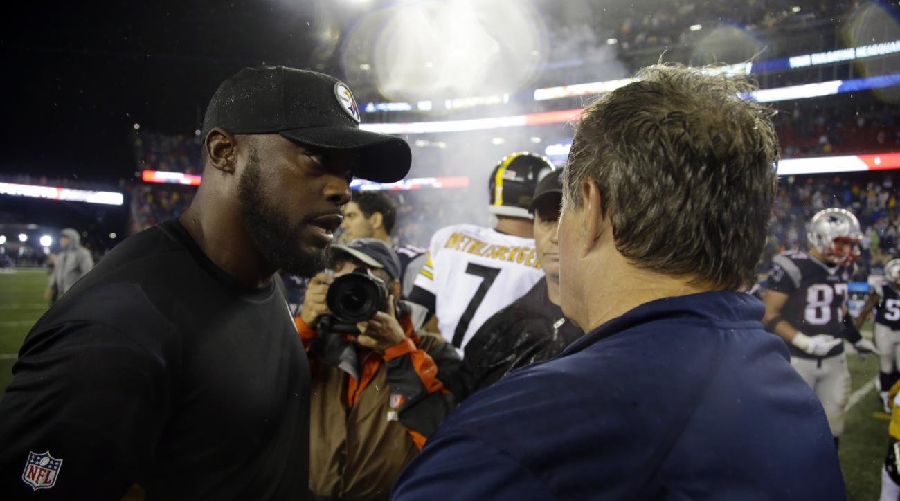 Pittsburgh Steelers head coach Mike Tomlin, left, speaks with New England Patriots head coach Bill Belichick after the Patriots' 28-21 win in an NFL football game, Thursday, Sept. 10, 2015, in Foxborough, Mass. (AP Photo/Stephan Savoia)