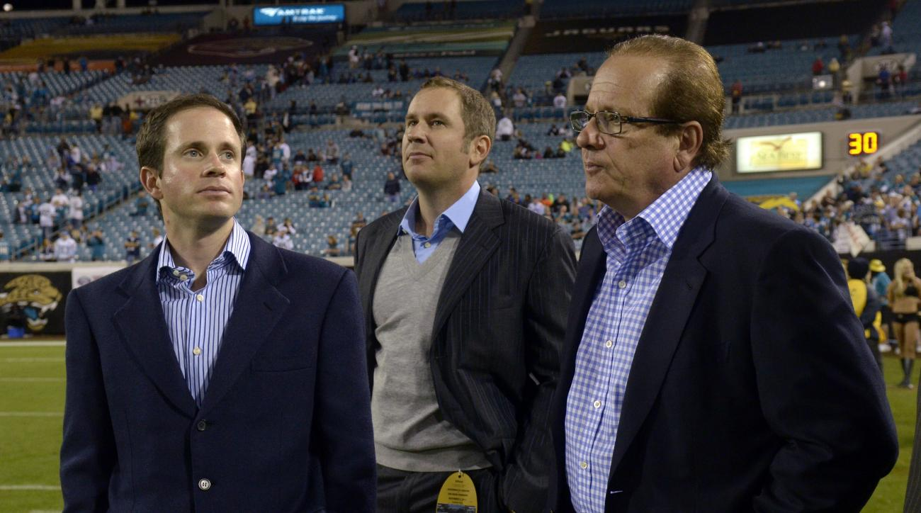 FILE - In this photo taken Dec. 5, 2011, San Diego Chargers Chairman of the Board Dean Spanos, right, and his sons John Spanos, left, and A.G. Spanos, watch from the sideline during the second half of an NFL football game against the Jacksonville Jaguars