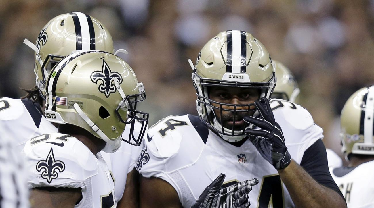 FILE - In this Aug. 22, 2015, file photo,New Orleans Saints defensive end Cameron Jordan (94) talks with teammates in the first half of a preseason NFL football game against the New England Patriots in New Orleans. Jordan said Friday, Sept. 11, 2015, that