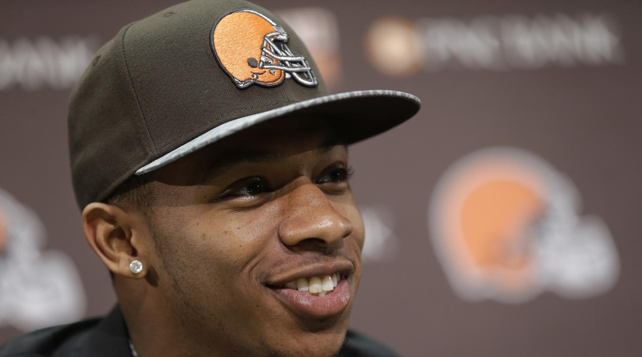 FILE - In this May 9, 2014, file photo, Cleveland Browns cornerback Justin Gilbert smiles during his introductory news conference at the NFL football team's facility in Berea, Ohio. Gilbert crashed his car into a ditch, Friday, Sept. 11, 2015, following w