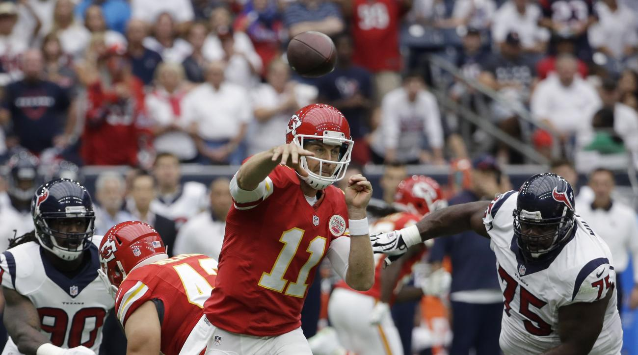 Kansas City Chiefs' Alex Smith (11) throws against the Houston Texans during the first half of an NFL football game Sunday, Sept. 13, 2015, in Houston. (AP Photo/David J. Phillip)
