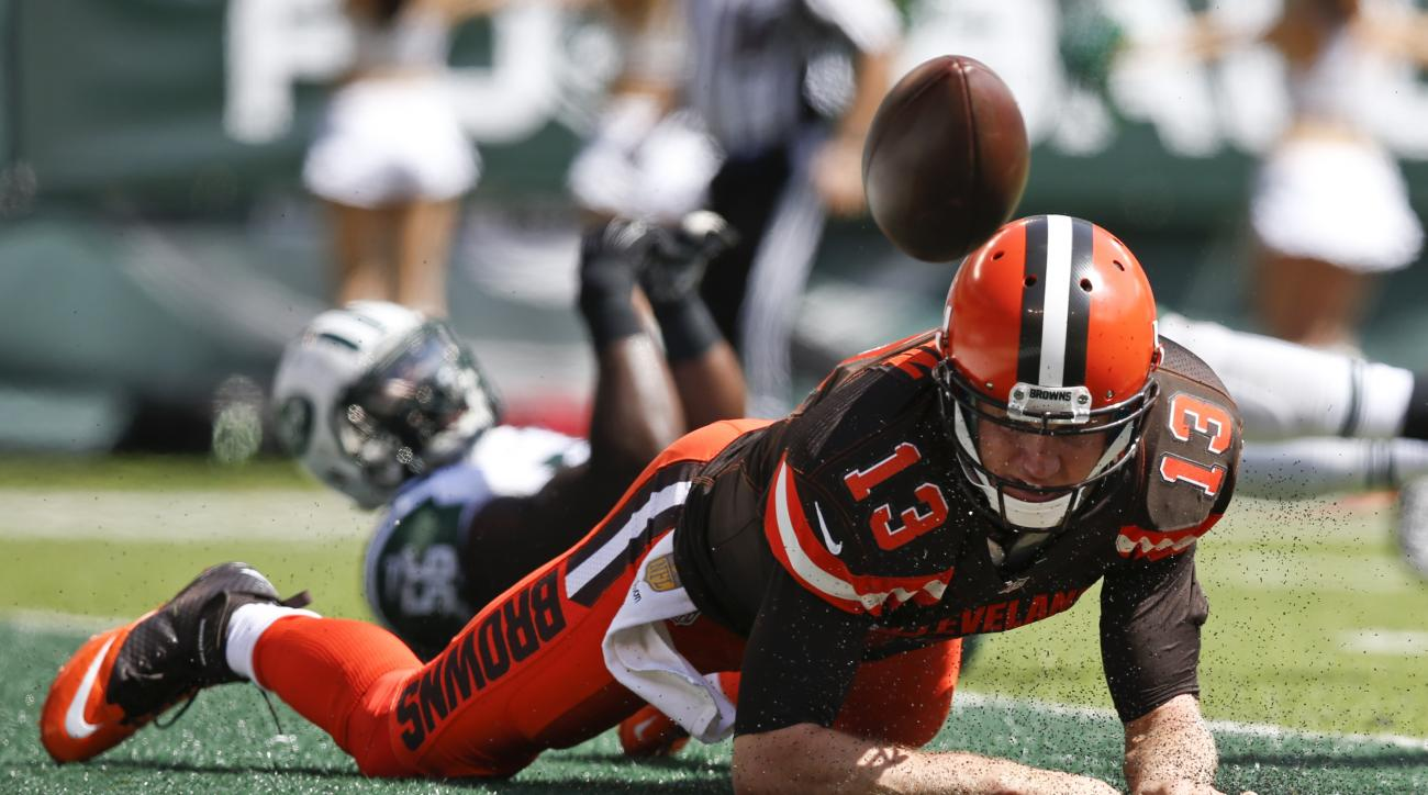 Cleveland Browns quarterback Josh McCown (13) fumbles the ball after being hit near the end zone during the first half of an NFL football game against the New York Jets Sunday, Sept. 13, 2015 in East Rutherford, N.J. (AP Photo/Kathy Willens)