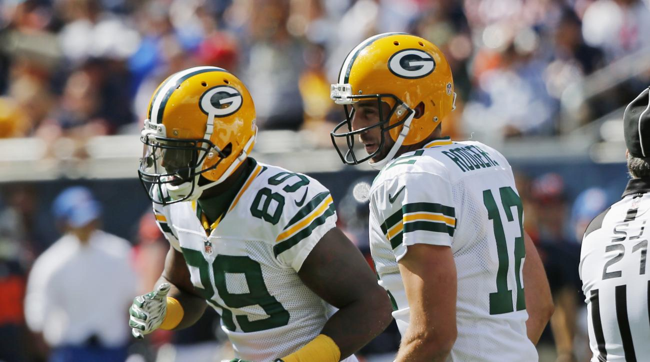 Green Bay Packers quarterback Aaron Rodgers (12) celebrates a touchdown with wide receiver James Jones (89) during the first half an NFL football game against the Chicago Bears, Sunday, Sept. 13, 2015, in Chicago. (AP Photo/Charles Rex Arbogast)