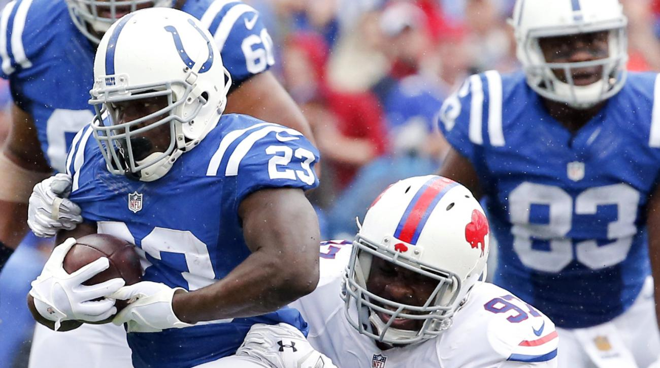 Indianapolis Colts running back Frank Gore (23) is tackled by Buffalo Bills defensive tackle Corbin Bryant (97) during the first half of an NFL football game on Sunday, Sept. 13, 2015, in Orchard Park, N.Y. (AP Photo/Bill Wippert)