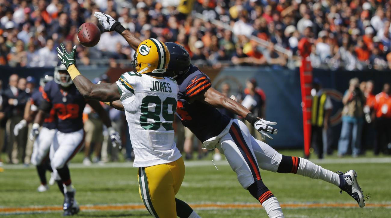 Green Bay Packers receiver James Jones (89) catches a pass under pressure from Chicago Bears defensive back Alan Ball during the first half an NFL football game, Sunday, Sept. 13, 2015, in Chicago. (AP Photo/Charles Rex Arbogast)