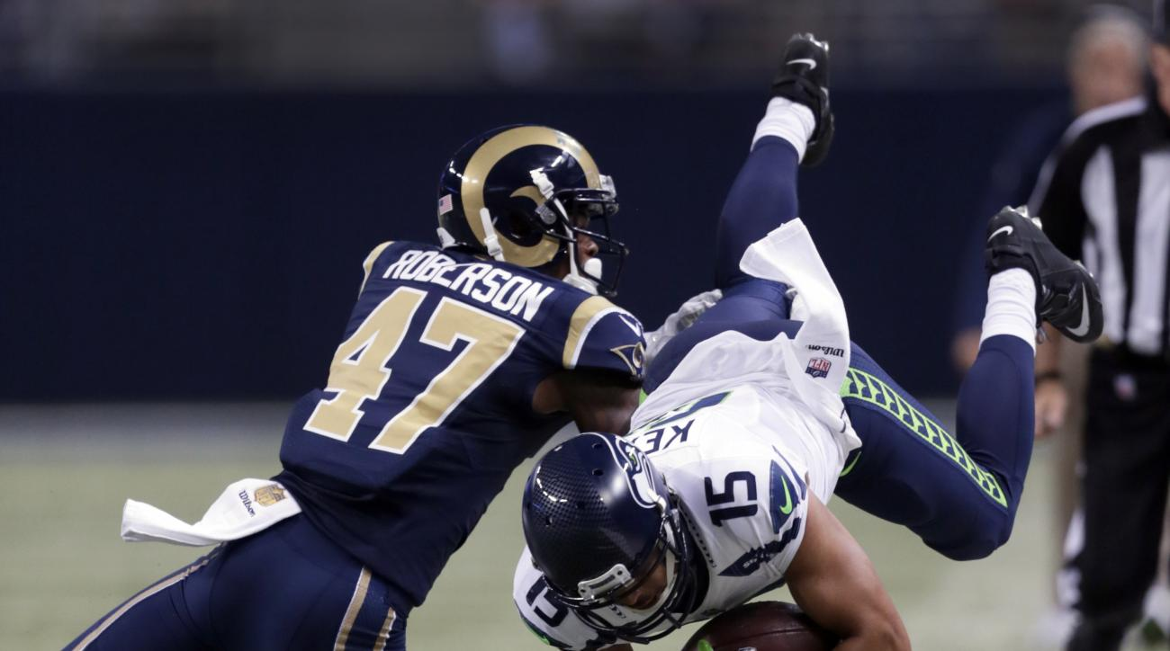 Seattle Seahawks wide receiver Jermaine Kearse, right, is stopped by St. Louis Rams cornerback Marcus Roberson after catching a pass for a 21-yard gain during the fourth quarter of an NFL football game Sunday, Sept. 13, 2015, in St. Louis. (AP Photo/Tom G