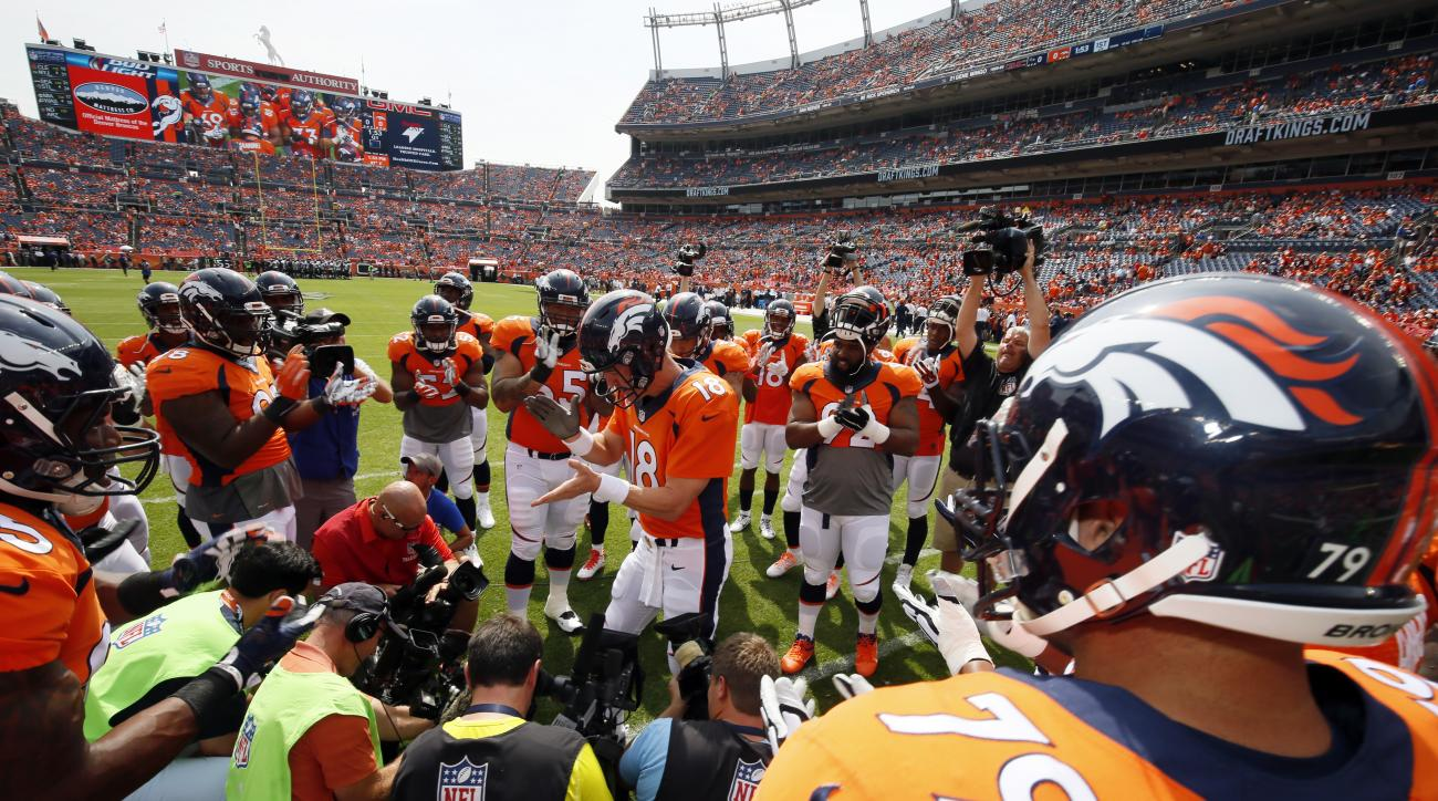 Denver Broncos quarterback Peyton Manning rallies the team before an NFL football game against the Baltimore Ravens Sunday, Sept. 13, 2015, in Denver. (AP Photo/Jack Dempsey)