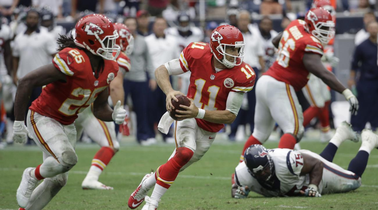 Kansas City Chiefs' Alex Smith (11) scrambles for yards against the Houston Texans during the second half of an NFL football game Sunday, Sept. 13, 2015, in Houston. (AP Photo/David J. Phillip)