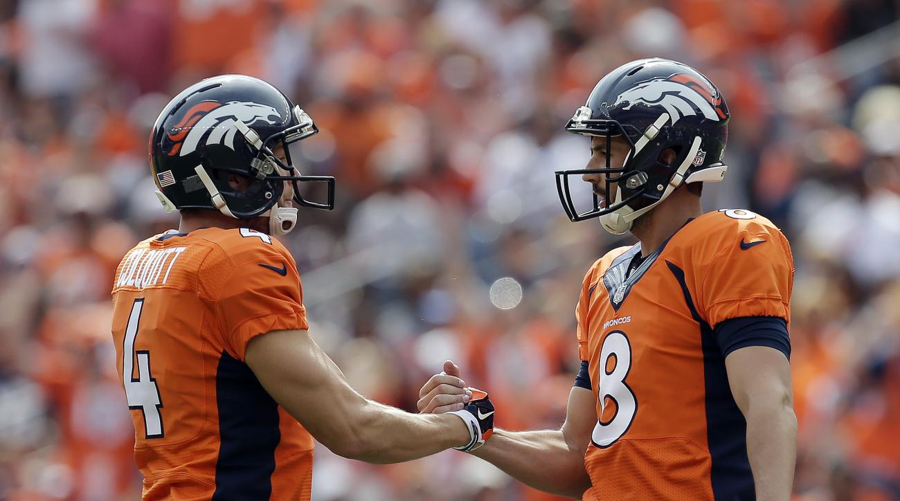 Denver Broncos kicker Brandon McManus, right, celebrates his field goal with Britton Colquitt during the first half of an NFL football game against the Baltimore Ravens  Sunday, Sept. 13, 2015, in Denver. (AP Photo/Joe Mahoney)