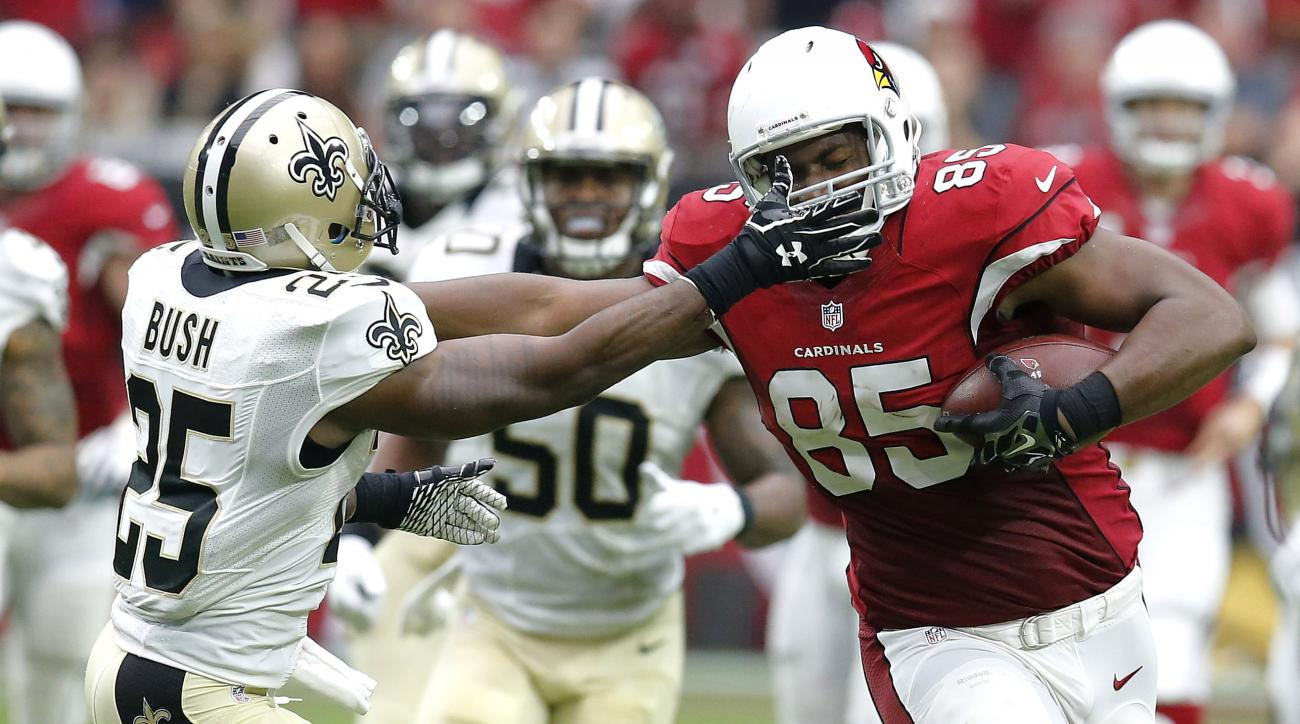 Arizona Cardinals tight end Darren Fells (85) runs as New Orleans Saints free safety Rafael Bush (25) pursue during the first half of an NFL football game, Sunday, Sept. 13, 2015, in Glendale, Ariz. (AP Photo/Rick Scuteri)